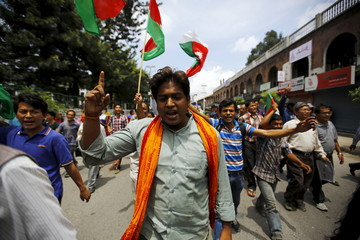 Protesters chant slogans as they march on the road during a general strike organised by a 30-party alliance led by a hardline faction of former Maoist rebels, who are protesting against the draft of the new constitution, in Kathmandu, Nepal