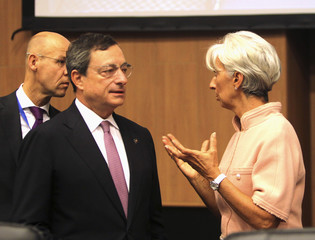 IMF Managing Director Lagarde and ECB President Draghi speak on the sidelines at ECOFIN meeting in Nicosia, Cyprus