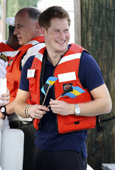Britain'sBritain's Prince Harry smiles as he  leaves after touring Harbour Island in Nassau