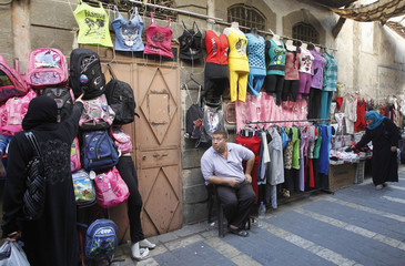 A street vendor is seen sits in old Damascus