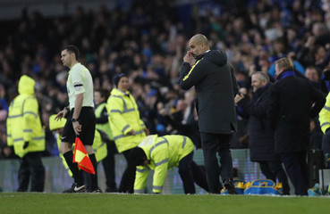 Manchester City manager Pep Guardiola looks dejected after Everton's fourth goal