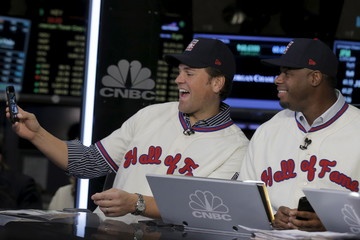 Former Major League Baseball players Mike Piazza and Ken Griffey Jr. pose for a selfie photo during an interview at the New York Stock Exchange