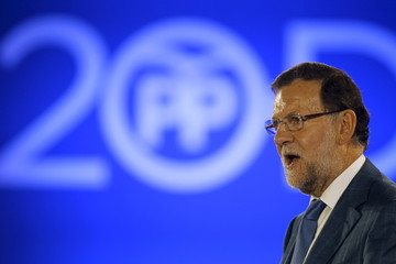 Spain's PM Rajoy delivers his speech during a party meeting on his electoral pre-campaign visit to Malaga
