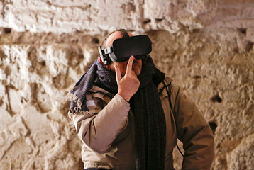 A man wears a virtual reality device during a visit at the Domus Aurea, built by Roman Emperor Nero in 64 A.D. and later buried by Emperor Trajan in Rome