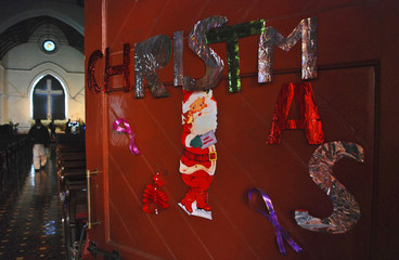 Christmas decorations are seen on a door at the St Johns Cathedral Church, on Christmas eve in Peshawar