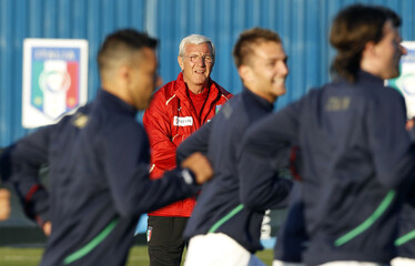 Italy's coach Marcello Lippi watches the players during a soccer training session in Irene
