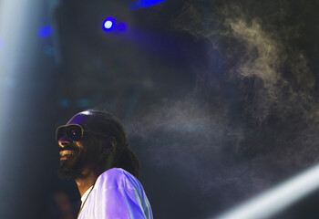 Rapper Snoop Dogg reacts while performing in a discotheque at an event organized for the spring break season, in Cancun