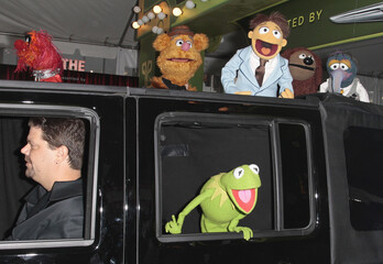 """Muppets cast members Kermit the Frog, Animal, Fozzie Bear, Walter, Rowlf, and Gonzo arrive at the """"The Muppets"""" world premiere in Hollywood"""