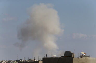 Smoke billows in the sky after a warplane belonging to Libyan pro-government forces bombed sites occupied by the Shura Council of Libyan Revolutionaries in Benghazi, Libya
