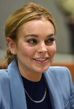 Actress Lindsay Lohan smiles during a progress report hearing in her DUI case at Airport Branch Courthouse in Los Angeles, California