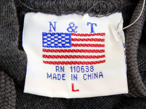 The label of a Washington D.C. sweatshirt bears a U.S. flag but says Made in China at a souvenir stand in Washington