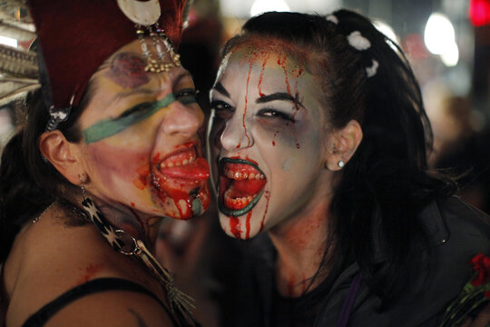 Women dressed up as zombies pose for a picture during an event in New York