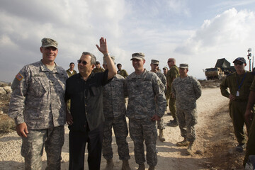Israel's Defence Minister Barak stands with U.S. soldiers as he visits a Patriot anti-missile battery west of Jerusalem