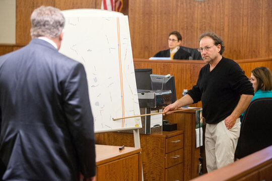 Witness Gary Ferrara, points out the location of his station on a map, during the murder trial of former New England Patriots player Aaron Hernandez at the Bristol County Superior Court in Fall River