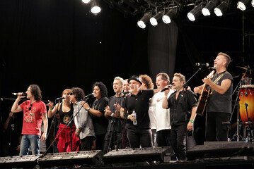 "Members of the Argentine band ""Los Fabulosos Cadillacs"" and other musicians perform during the ""Argentina embrace Chile"" benefit concert in Buenos Aires"