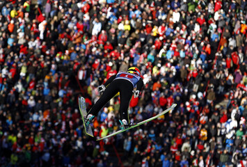 Norway's Hilde soars over thousands of spectators in third event of Four-Hills ski jumping tournament in Innsbruck