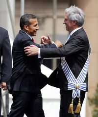 Ollanta Humala greets Tabare Vazquez after Vazquez received the presidential sash from Jose Mujica in Montevideo