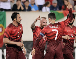Portugal's Meireles and Ronaldo celebrate with Almeida after his goal against Ireland during friendly soccer match in East Rutherford