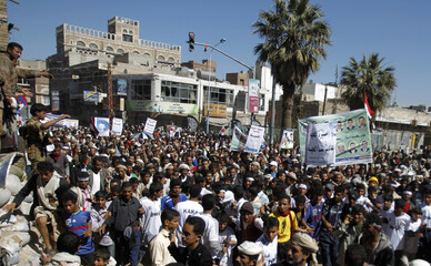 Anti-government protesters march to demand that Yemen's outgoing President Ali Abdullah Saleh be tried, in Sanaa