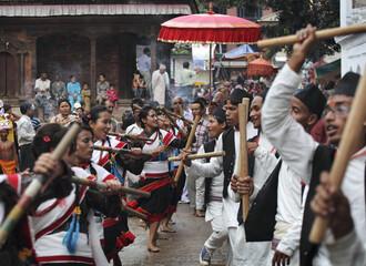 Revellers perform traditional dances during the Gaijatra parade in Kathmandu
