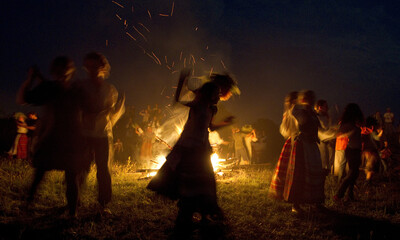 People dance as they take part in the Ivan Kupala festival near the town of Rakov