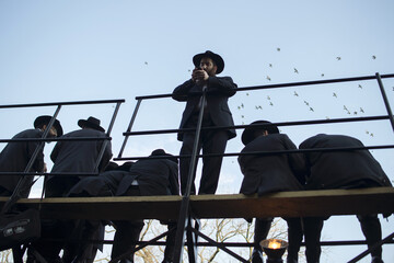 Rabbis from the Chabad-Lubavitch movement of Judaism wait to take part in a group photograph as part of a convention of 3,000 rabbis from around the world in the Brooklyn Borough of New York