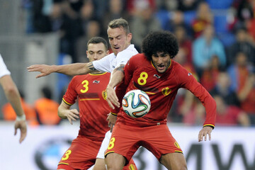 Luxembourg's Joachim fights for the ball with Belgium's Vermaelen and Fellaini during their international friendly soccer match in Genk