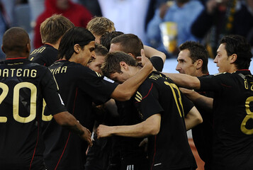 Germany's Mueller celebrates with team mates after scoring against Argentina during their World Cup quarter-final soccer match at Green Point stadium in Cape Town