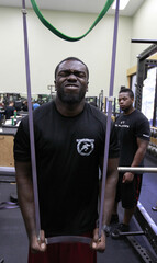 McFadden stretches during workouts with other NFL hopefuls at the Bommarito Performance Systems facility in North Miami Beach