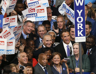Delegates from the state of New York stand with signs at the Democratic National Convention in Philadelphia