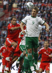 Doyle of Ireland outjumps Shirokov of Russia during their Euro 2012 Group B qualifying soccer match at Luzhniki Stadium in Moscow