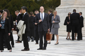 Clement prepares to approach reporters outside the U.S. Supreme Court in Washington