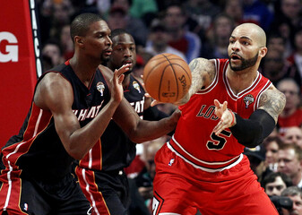 Miami Heat's Bosh pressures Chicago Bulls' Boozer during their NBA basketball game in Chicago