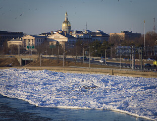 Ice flows jam the Delaware River as the Capitol building is pictured in the background in Trenton