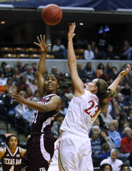 Aggies' Colson shoots over Cardinals' Pohlen during their semi-final NCAA women's Final Four college basketball game in Indianapolis