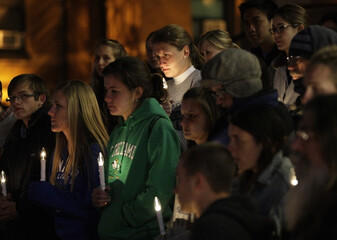"""Supporters of """"Missourians for Alternatives to the Death Penalty"""" (MADP) attend a candlelight vigil for death row inmate Joseph Franklin on the steps of St. Francis Xavier Church in St. Louis"""