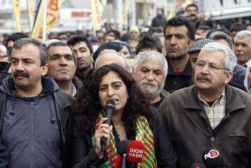 BDP Parliamentarians Sebahat Tuncel and Ufuk Uras attend a protest against the High Election Board's decision in central Istanbul