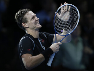 Berdych of the Czech Republic celebrates winning his men's singles tennis match against Ferrer of Spain at the ATP World Tour Finals at the O2 Arena in London