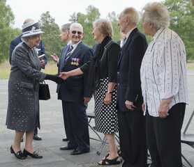 Britain's Queen Elizabeth speaks with Levy, Levy, Brown und Lasker-Wallfisch during a visit to the site of the former Nazi concentration camp Bergen-Belsen