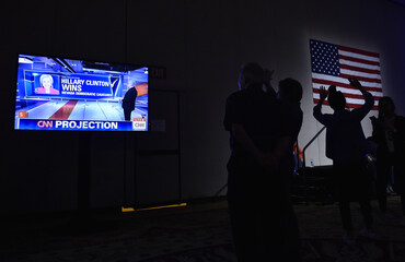 A news broadcast projects Democratic U.S. presidential candidate Clinton as winner of the Nevada caucuses in Las Vegas