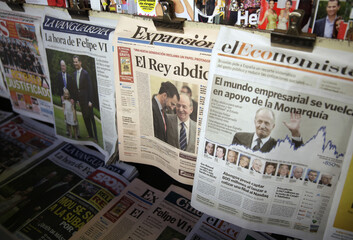 Spanish national newspapers with front page news of Spain's King Juan Carlos' abdication are seen displayed on a kiosk in Madrid