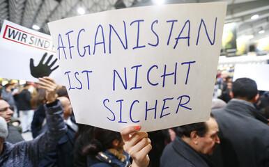 Protesters demonstrate against the repatriation of Afghan asylum seekers at Frankfurt airport