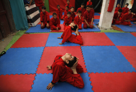 Palestinian boys participate during a class at the Red Dragon martial arts club in Beit Lahiya