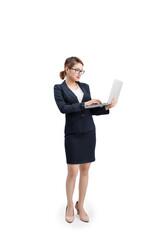 Full length of a young female businesswoman holding laptop over grey background.