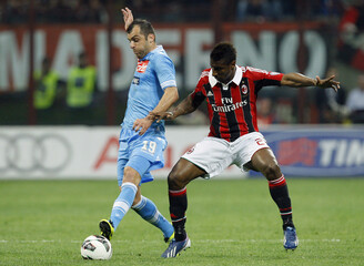 AC Milan's Constant fights for ball with Napoli's Pandev during Italian Serie A soccer match in Milan