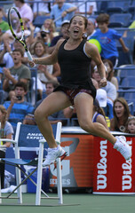 Irina Falconi of the U.S. celebrates after defeating Dominika Cibulkova of Slovakia in their match at the U.S. Open tennis tournament in New York