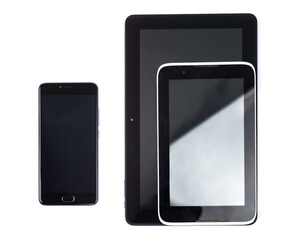 Black cell phone with blank screen and tablet pc computer in metal basket