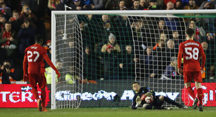 Liverpool's Divock Origi has his penalty saved by Plymouth Argyle's Luke McCormick