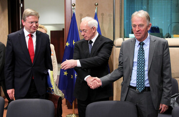 Ukraine's PM Azarov poses with European Enlargement Commissioner Fule and Denmark's FM Sovndal in Brussels