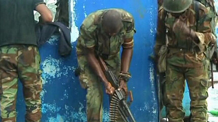 Still image from video shows troops loyal to Ivory Coast presidential claimant Alassane Ouattara preparing their weapons